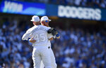 Los Angeles Dodgers' Justin Turner, right, celebrates with Matt Beaty after a baseball game against the New York Yankees in Los Angeles, Saturday, Aug. 24, 2019. (AP Photo/Kelvin Kuo)