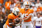 Tennessee quarterback Harrison Bailey (15) hands the ball off to running back Len'Neth Whitehead (27) during the second half of an NCAA college football game against Tennessee Tech, Saturday, Sept. 18, 2021, in Knoxville, Tenn. Tennessee won 56-0. (AP Photo/Wade Payne)