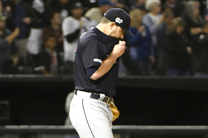 Cleveland Indians starting pitcher Aaron Civale reacts after giving up a three-run home run to Chicago White Sox's James McCann during the fourth inning of a baseball game Thursday, Sept. 26, 2019, in Chicago. (AP Photo/David Banks)