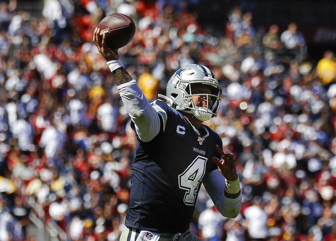 Dallas Cowboys quarterback Dak Prescott (4) passes the ball during the first half of an NFL football game against Washington Redskins, Sunday, Sept. 15, 2019, in Landover, Md. (AP Photo/Evan Vucci)