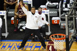 Boston head coach Scott Spinelli directs his team during the first half of an NCAA college basketball game in the first round of the Atlantic Coast Conference tournament in Greensboro, N.C., Tuesday, March 9, 2021. (AP Photo/Gerry Broome)