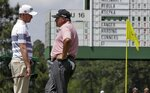 Justin Harding talks to Angel Cabrera, of Argentina, on the 17th hole during the first round for the Masters golf tournament Thursday, April 11, 2019, in Augusta, Ga. (AP Photo/David J. Phillip)