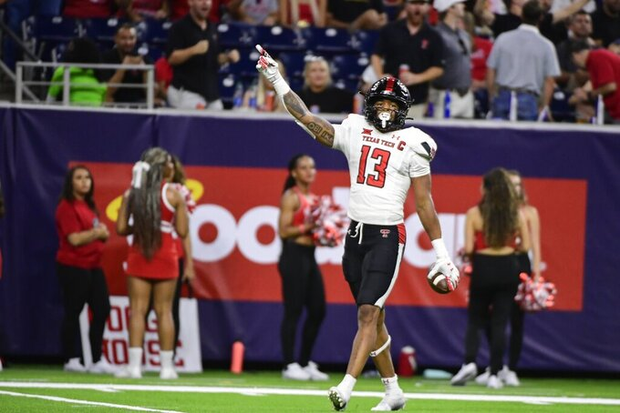 Texas Tech Red Raiders wide receiver Erik Ezukanma (13) reacts to catching a pass against Houston during the second half of an NCAA college football game Saturday, Sept. 4, 2021, in Houston. (AP Photo/Justin Rex)