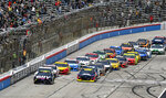 Jimmie Johnson, front left, leads the field at the start of a NASCAR Cup auto race at Texas Motor Speedway, Sunday, March 31, 2019, in Fort Worth, Texas. (AP Photo/Larry Papke)