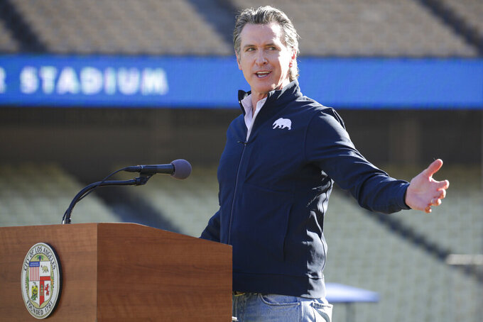 FILE - In this Jan. 15, 2021, file photo, Governor Gavin Newsom addresses a press conference held at the launch of a mass COVID-19 vaccination site at Dodger Stadium in Los Angeles. California could become the next testing ground for the nation's roiled, unpredictable politics: It's possible the state known as a Democratic stronghold and beacon for progressive ideals could dump Newsom. (Irfan Khan/Los Angeles Times via AP, Pool, File)