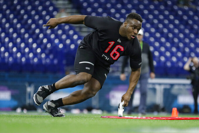 Texas A&M defensive lineman Justin Madubuike runs a drill at the NFL football scouting combine in Indianapolis, Saturday, Feb. 29, 2020. (AP Photo/Michael Conroy)
