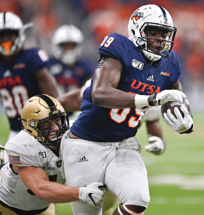 UTSA's Leroy Watson (89) is tackled by Army's Cole Christiansen during the second half of an NCAA college football game Saturday, Sept. 14, 2019, in San Antonio. (AP Photo/Darren Abate)
