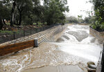 Hot Springs Creek flows into a debris basin after heavy rain in  Santa Barbara, Calif., Wednesday, March 6, 2019.  A downpour rolled into California with spectacular lightning and thunderclaps Tuesday night in one of the most electric storm systems of the winter. The storm was the latest atmospheric river to flow into California this winter. The National Weather Service reported