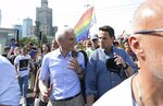 File- In this Saturday, June 8, 2019 file photo, Warsaw Mayor Rafal Trzaskowski, right, speaks with former Warsaw Mayor Marcin Swiecicki, as they walk in support of the gay pride parade in Warsaw. Trzaskowski, a pro-European Union liberal, has recently joined the race for the nation's president and has emerged as the main challenger to incumbent President Andrzej Duda who had previously seemed certain to win. The date of the vote is yet to be announced.(AP Photo/Czarek Sokolowski, file)