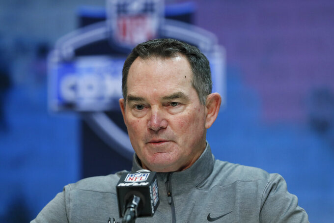 FILE - In this Feb. 26, 2020, file photo, Minnesota Vikings head coach Mike Zimmer speaks during a news conference at the NFL football scouting combine in Indianapolis. The Vikings signed head coach Zimmer on Friday, July 24, 2020, to a three-year contract extension through the 2023 season. Zimmer's record with the Vikings over six years is 57-38-1, plus 2-3 in the postseason. (AP Photo/Charlie Neibergall, File)
