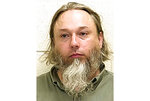 FILE - This undated file photo provided by The Ford County Sheriff's Office in Paxton, Ill., shows Michael Hari, a militia leader convicted of masterminding the bombing of a Minnesota mosque, Hari is now known by her transgender identity, Emily Claire Hari. Hari, the leader of an Illinois anti-government militia group who authorities say masterminded the 2017 bombing of a Minnesota mosque is to be sentenced Monday, Sept. 13, 2021. Emily Claire Hari, who was previously known as Michael Hari and recently said she is transgender, faces a mandatory minimum of 30 years in prison for the attack on Dar al-Farooq Islamic Center. (Ford County Sheriff's Office via AP File)