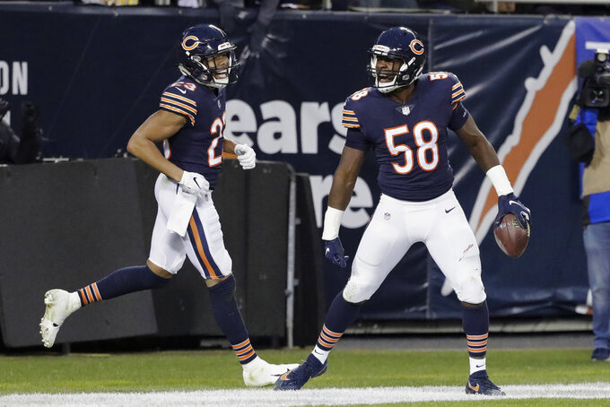 Chicago Bears inside linebacker Roquan Smith (58) celebrates in the end zone after intercepting a pass during the first half of an NFL wild-card playoff football game against the Philadelphia Eagles Sunday, Jan. 6, 2019, in Chicago. Smith did not score after being ruled down at the point of the interception. (AP Photo/Nam Y. Huh)