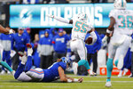 Miami Dolphins outside linebacker Jerome Baker (55) runs with the ball past New York Giants offensive guard Nick Gates (65) in the second half of an NFL football game, Sunday, Dec. 15, 2019, in East Rutherford, N.J. (AP Photo/Adam Hunger)