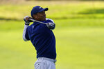Tiger Woods watches his tee shot on the ninth hole during the third round of the PGA Championship golf tournament at TPC Harding Park Saturday, Aug. 8, 2020, in San Francisco. (AP Photo/Jeff Chiu)