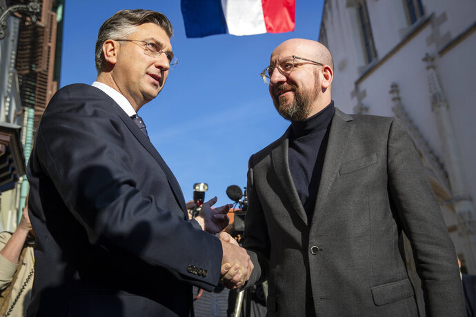 President of the European Council Charles Michel, right, is welcomed by Croatia's prime minister Andrej Plenkovic in Zagreb, Croatia, Thursday, Jan. 9, 2020. Croatia took over the presidency of the Council of the European Union on Jan. 1, 2020 from Finland, six and a half years after entering the European bloc. (AP Photo/Darko Bandic)