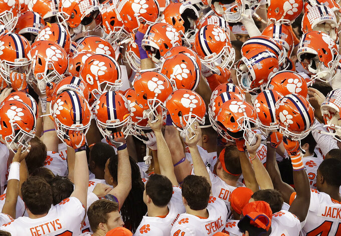 FILE - In this Jan. 7, 2019, file photo, Clemson players huddle before the NCAA college football playoff championship game against Alabama in Santa Clara, Calif. Clemson's most recent national championship football team also met the mark in the classroom. On Tuesday, May 12, 2020, the Tigers' 2018 football team was one of 10 national champs to earn recognition from the NCAA for their Academic Progress Rate scores. (AP Photo/Jeff Chiu, File)