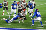 New York Giants linebacker Carter Coughlin (49) tackles Cleveland Browns quarterback Baker Mayfield (6) during the first half of an NFL football game, Sunday, Dec. 20, 2020, in East Rutherford, N.J. (AP Photo/Seth Wenig)