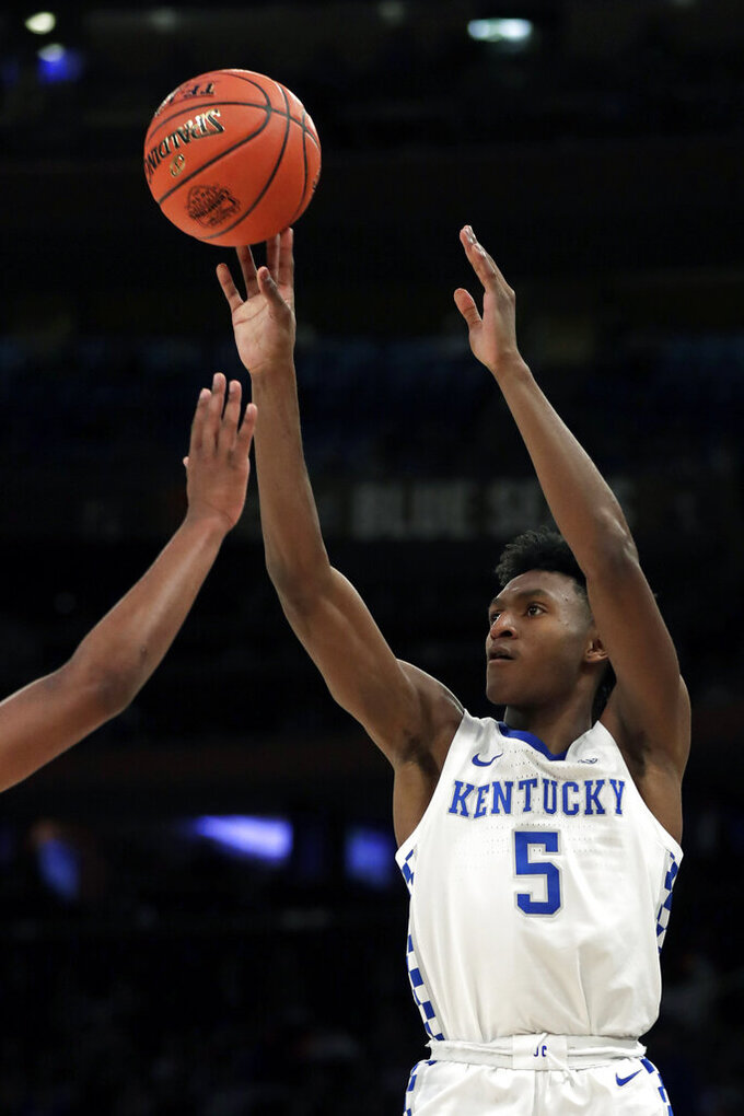 Kentucky guard Immanuel Quickley (5) shoots against Michigan State during the second half of an NCAA college basketball game Tuesday, Nov. 5, 2019, in New York. Kentucky won 69-62. (AP Photo/Adam Hunger)