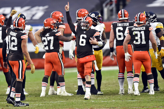 Cleveland Browns quarterback Baker Mayfield celebrates after the team defeated the Pittsburgh Steelers in an NFL football game, Sunday, Jan. 3, 2021, in Cleveland. (AP Photo/David Richard)
