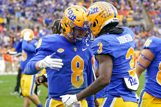 Pittsburgh quarterback Kenny Pickett (8) celebrates with wide receiver Jordan Addison (3) after throwing him a touchdown pass against Clemson during the first half of an NCAA college football game, Saturday, Oct. 23, 2021, in Pittsburgh. (AP Photo/Keith Srakocic)