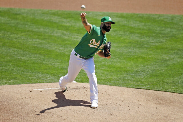 Oakland Athletics pitcher Mike Fiers works against the Texas Rangers in the first inning of a baseball game Thursday, Aug. 6, 2020, in Oakland, Calif. (AP Photo/Ben Margot)