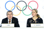 International Olympic Committee (IOC) president Thomas Bach, left, and IOC member and former swimmer Kirsty Coventry, right, speak during a press conference after the executive board meeting of the IOC, at the Olympic House, in Lausanne, Switzerland, Thursday, Jan. 9, 2020. (Laurent Gillieron/Keystone via AP)
