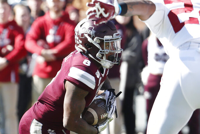 Mississippi State running back Kylin Hill (8) goes low as he dives into the end zone for a one-yard touchdown run against Alabama during the first half of an NCAA college football game in Starkville, Miss., Saturday, Nov. 16, 2019. Alabama won 38-7. (AP Photo/Rogelio V. Solis)