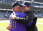 Colorado Rockies starting pitcher Peter Lambert, right, gets hug from Colorado Rockies manager Bud Black (10) after getting his first major league win against the Chicago Cubs in a baseball game against the Chicago Cubs, Thursday, June, 6, 2019, in Chicago. (AP Photo/David Banks)
