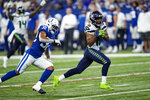 Seattle Seahawks wide receiver Tyler Lockett (16) makes catch in front of Indianapolis Colts safety Julian Blackmon (32) on his way to a touchdown during the first half of an NFL football game in Indianapolis, Sunday, Sept. 12, 2021. (AP Photo/AJ Mast)