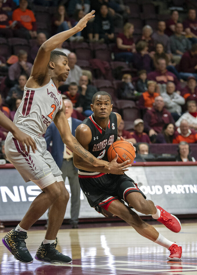 Virginia Tech guard Landers Nolley II (2) guards Gardner-Webb forward Eric Jamison Jr. (2) driving the ball during the first half of an NCAA college basketball game Sunday, Dec. 15, 2019 in Blacksburg, Va. (Don Petersen/Roanoke Times via AP)