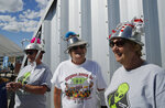 From left, sisters Kathy Richey, Gerry Garcia and Sandy Haney wait in line for the gift shop at the Storm Area 51 Basecamp event Friday, Sept. 20, 2019, in Hiko, Nev. The event was inspired by the