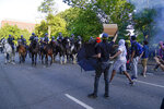 Police on horseback begin to approach demonstrators who had gathered to protest the death of George Floyd, Monday, June 1, 2020, near the White House in Washington. Floyd died after being restrained by Minneapolis police officers. (AP Photo/Evan Vucci)