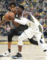 Indiana Pacers guard Darren Collison, right, moves with the basketball defended by Brooklyn Nets guard D'Angelo Russell in the first half of an NBA basketball game, Saturday, Oct. 20, 2018, in Indianapolis. (AP Photo/R Brent Smith)