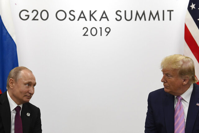 FILE - In this June 28, 2019, file photo President Donald Trump, right, meets with Russian President Vladimir Putin during a bilateral meeting on the sidelines of the G-20 summit in Osaka, Japan. If Trump doesn't extend the New Strategic Arms Reduction Treaty, only remaining U.S.-Russia arms control pact, or succeed in negotiating a replacement treaty,  it will expire on Feb. 5, 2021.  (AP Photo/Susan Walsh, File)
