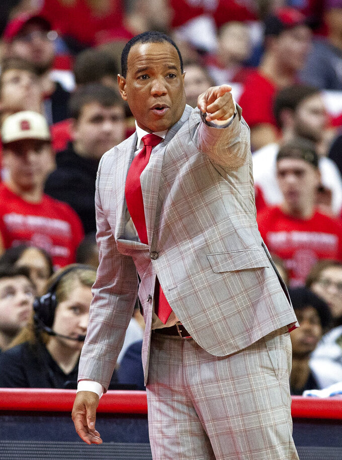 North Carolina State Head Coach Kevin Keatts directs his team during the first half of an NCAA college basketball game against Virginia Tech in Raleigh, N.C., Saturday, Feb. 2, 2019. (AP Photo/Ben McKeown)