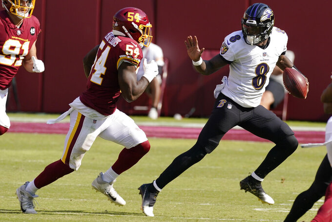 Baltimore Ravens quarterback Lamar Jackson (8) runs against the Washington Football Team during the second half of an NFL football game, Sunday, Oct. 4, 2020, in Landover, Md. (AP Photo/Steve Helber)