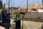 Sonoma County Supervisor James Gore speaks during a news conference, Wednesday, July 11, 2018, in Santa Rosa, Calif., in a neighborhood that was destroyed by wildfires in October 2017. Victims of California's deadliest wildfires and local politicians are calling on state lawmakers to stop trying to overhaul the state's liability laws on wildfires. (AP Photo/ Lorin Eleni Gill)