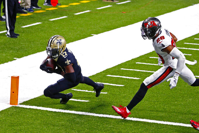 New Orleans Saints wide receiver Emmanuel Sanders (17) scores on a touchdown reception against Tampa Bay Buccaneers defensive back Andrew Adams (26) in the second half of an NFL football game in New Orleans, Sunday, Sept. 13, 2020. (AP Photo/Butch Dill)