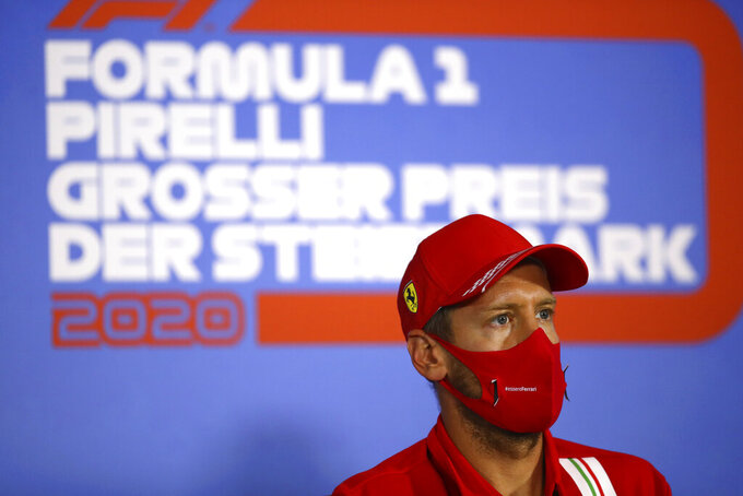 Ferrari driver Sebastian Vettel of Germany speaks during a news conference at the Red Bull Ring racetrack in Spielberg, Austria, Thursday, July 9, 2020. Styrian Formula One Grand Prix will be held on Sunday. (Bryn Lennon/Pool via AP)