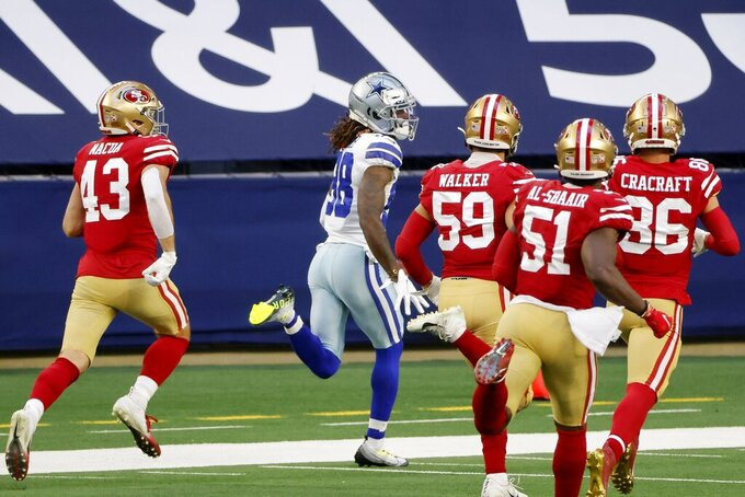 Dallas Cowboys wide receiver CeeDee Lamb (88) sprints to the end zone returning an onside kick for a touchdown as San Francisco 49ers Kai Nacua (43), Joe Walker (59), Azeez Al-Shaair (51) and River Cracraft (86) give pursuit in the second half of an NFL football game in Arlington, Texas, Sunday, Dec. 20, 2020. (AP Photo/Michael Ainsworth)