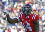 Mississippi wide receiver D.K. Metcalf (14) gestures before a play during the first half of an NCAA college football game against Louisiana Monroe in Oxford, Miss., Saturday, Oct. 6, 2018. (AP Photo/Thomas Graning)