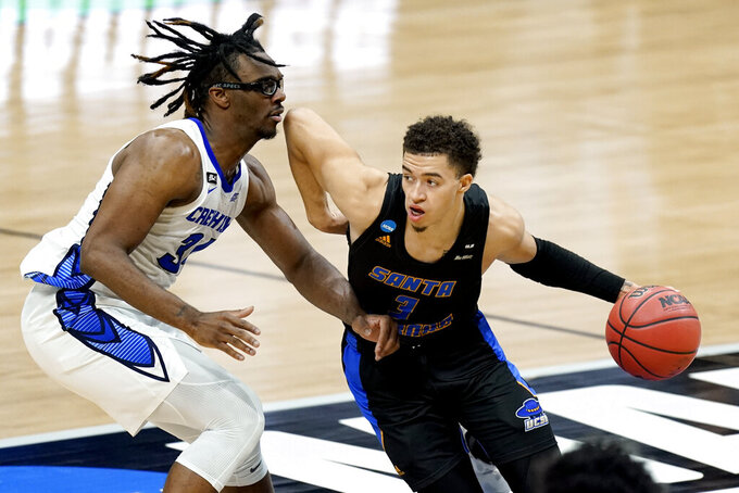 UC Santa Barbara's JaQuori McLaughlin (3) drives against Creighton's Denzel Mahoney, left, during the first half of a college basketball game in the first round of the NCAA tournament at Lucas Oil Stadium in Indianapolis Saturday, March 20, 2021. (AP Photo/Mark Humphrey)