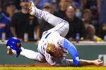 New York Mets' Pete Alonso rolls over home plate after being tagged out by Boston Red Sox catcher Christian Vazquez, while trying to score on a single by Michael Conforto, during the fourth inning of a baseball game at Fenway Park, Tuesday, Sept. 21, 2021, in Boston. (AP Photo/Charles Krupa)
