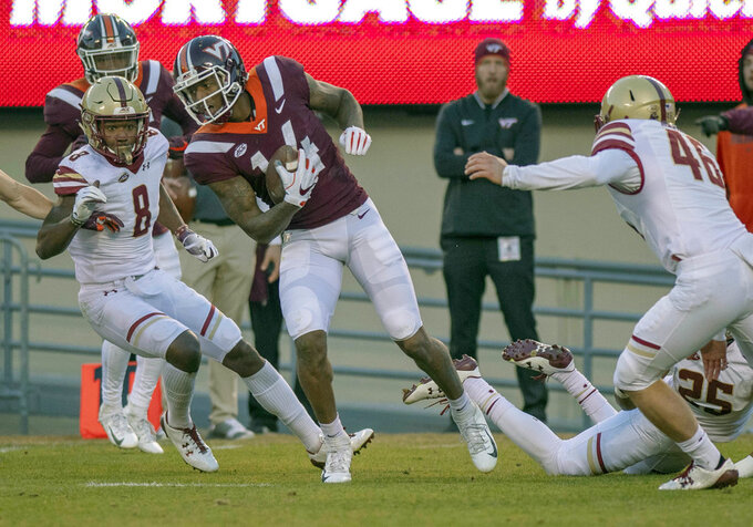Virginia Tech wide receiver Damon Hazelton breaks free for a gain of yards in the second half of an NCAA college football  game against Boston College in Blacksburg Va., Saturday, Nov. 3 2018. Boston College won the game 31-21. (Matt Gentry/The Roanoke Times via AP)