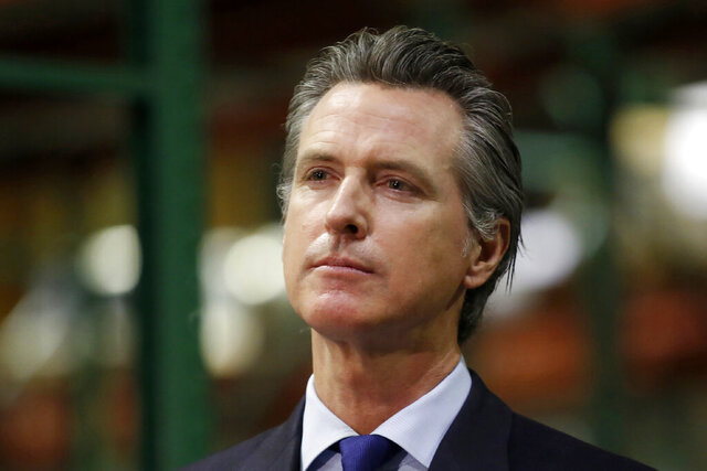 FILE - In this June 26, 2020, file photo, California Gov. Gavin Newsom listens to a reporter's question during a news conference in Rancho Cordova, Calif. Gov. Newsom is facing a possible recall election as the nation's most populous state struggles to emerge from the coronavirus crisis. Organizers say they have collected more than half of the nearly 1.5 million petition signatures needed to place the recall on the ballot. (AP Photo/Rich Pedroncelli, Pool, File)