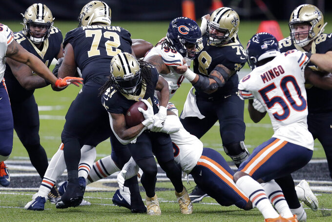 New Orleans Saints running back Alvin Kamara (41) carries in the first half of an NFL wild-card playoff football game against the Chicago Bears in New Orleans, Sunday, Jan. 10, 2021. (AP Photo/Brett Duke)