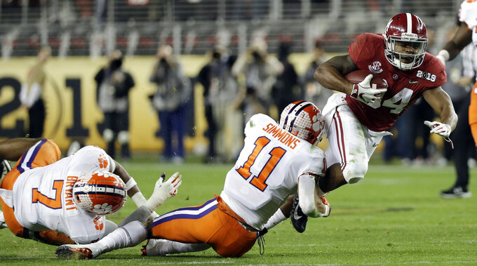 Clemson's Isaiah Simmons stops Alabama's Damien Harris during the second half of the NCAA college football playoff championship game, Monday, Jan. 7, 2019, in Santa Clara, Calif. (AP Photo/David J. Phillip)