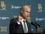 FILE - In this Jan. 20, 2020, file photo, Baylor's new head football coach Dave Aranda addresses the media during an NCAA college football news conference in Waco, Texas. Just when it seemed like things were up and rolling, the COVID-19 pandemic hit. The ensuring national shutdown hurt coaches across college football as they prepare for next season, but it was particularly difficult on programs with first-year coaches trying to build something from the ground up. (Jerry Larson/Waco Tribune-Herald via AP, File)