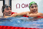 Tatjana Schoenmaker, right, of South Africa, celebrates after her women's 200-meter breaststroke semifinal with Annie Lazor, of the United States, at the 2020 Summer Olympics, Thursday, July 29, 2021, in Tokyo, Japan. (AP Photo/Matthias Schrader)