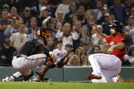 Baltimore Orioles catcher Chance Sisco, left, waits to tag Boston Red Sox's Sam Travis out at the plate in the fourth inning of a baseball game at Fenway Park, Friday, Sept. 27, 2019, in Boston. (AP Photo/Elise Amendola)